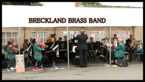 breckland brass band performing in the memorial hal car park for walsham-le-willows open gardens weekend