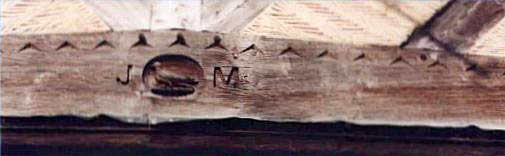 Detailed photograph of the image of John Martineau and his initials carved on one of the cottages in Walsham