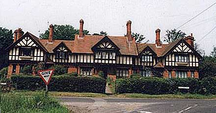 Colour photograph of mock-Jacobean cottages in Eversley, similar to those in Walsham.