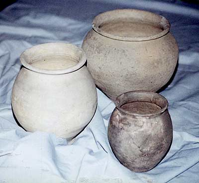 Photograph of three small, grey, spherical cooking pots with round rims made at Wattisfield during the 1st-4th century.