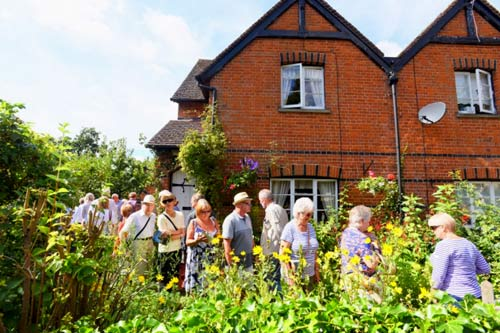Walsham-le-Willows open-gardens. Visitors enjoying one of the gardens.