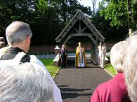 Bishop of Dunwich under the lychgate during teh consecration ceremony