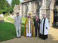 the bishop of Dunwich in a photocall with the local priest