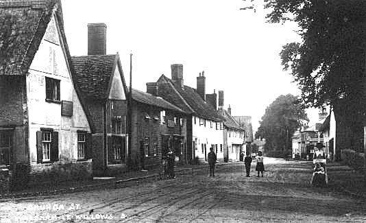"A photograph of ""The Street"" looking from in front of the Six Bells i.e. the crossroads. This was taken arround 1900."