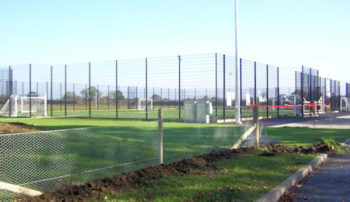 Image of new sports area, fenced of football pitches