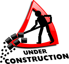 red road triangular sign inside which a contruction worker is sweeping up...