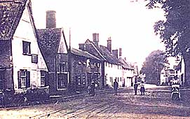 image of main street of Walsham with dirt road