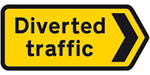 yellow road sign for traffic diversion