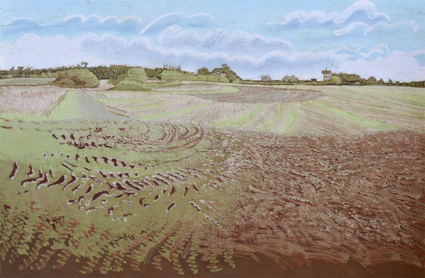 Pastel shades depicting a cultivated field with prominent patterns on the earth in the foreground leading to a horizon with woodland against a blue cloud filled sky
