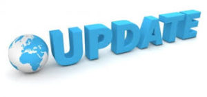 image of three dimensional letters in blue each standing to form the word 'update' with and representation of the world globe to the left