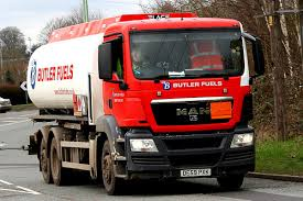red and white butler fuels lorry