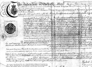 "A copy of part of an old Indenture, and has official seals on the left, with about 18 lines of hand written script on the rest of the certificate testifying that Herbert Pike had passed his Apprenticeship in ""The Art of a Grocer and Draper"". The heading and script at the top is particularly aesthetically pleasing."