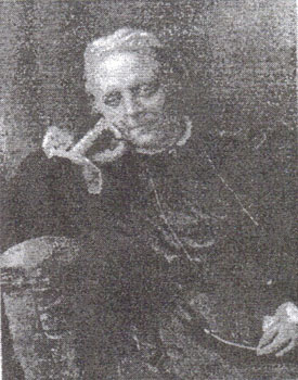 An old black and white photograph of Caroline Martineau leaning her elbow on back of chair and supporting her head with her curled knuckles to her cheek.