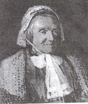 An old black and white photograph of Mary Constance Martineau wearing a lacy bonnet.