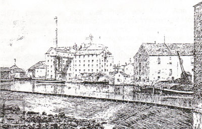 An old black and white photograph of Thomas Wharf, Wakefield, circa 1800 showing Malt Houses and Corn Mills along the river.
