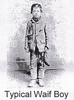 An old black and white photograph of a young boy of about 8 years of age.
