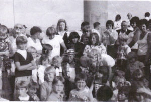 Charlie Studd on the promenade at Lowestoft surrounded by his adoring fans, the children who enjoyed his Outings.