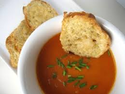 bowl of tomato soup and bread