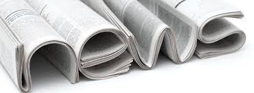 newspapers folded to form the letters forming the word 'news'