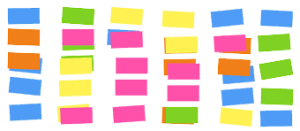 panel of multi-coloured post it notes set out in a grid
