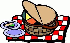 Picnic basket on chequered blanket