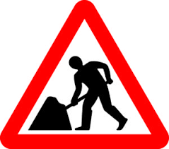 red triangle roadworks sign with work person in centre