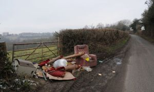 Photograph of rubbish fly tipping in rural area